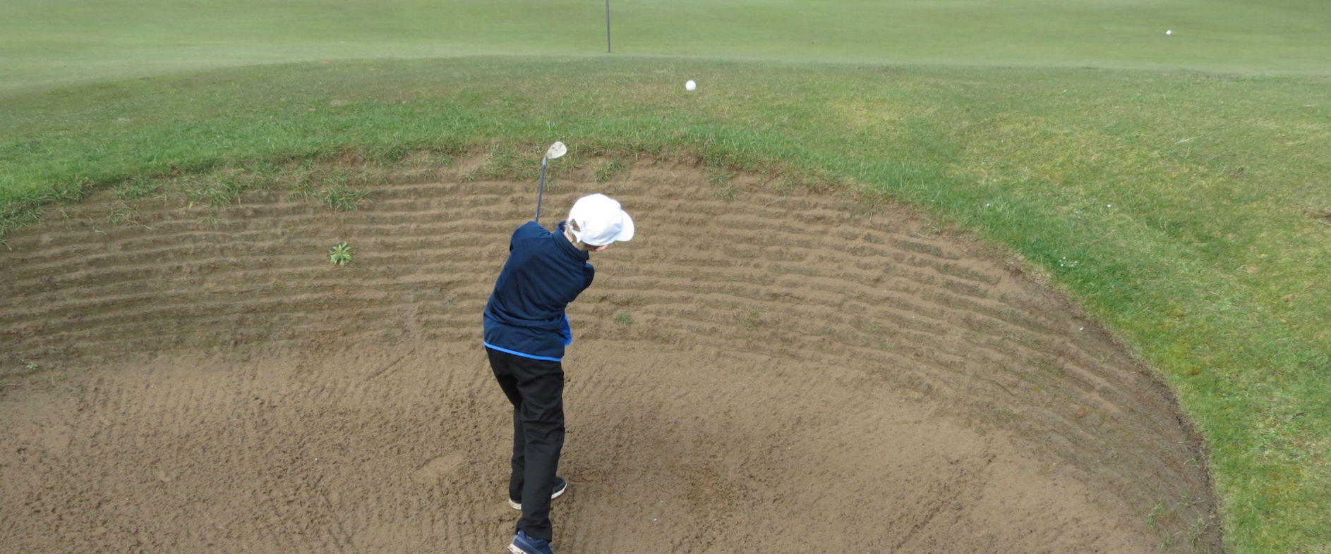Oliver Badger successfully escapes from one of the deep bunkers at Burnham and Berrow 15.3.20